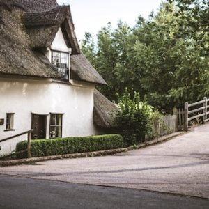 A thatched house set near a bridge